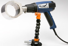 Hand-Held heat gun for applying clean seal capsules onto hydraulic assemblies