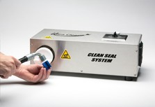 Bench-top production model heat-shrink machine for sealing hydraulic assemblies against airborne contamination